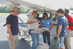 Jim Cawthon spoke to Birmingham Southern College students at his Cessna at Shelby County Airport.
