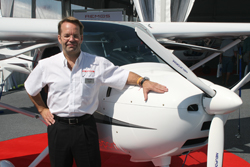 Remos Aircraft CEO Corvin Huber with the Remos GX light sport aircraft.