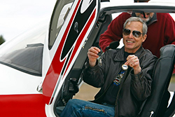 Michael Graves sits in the Cirrus SR22 and holds out the keys.
