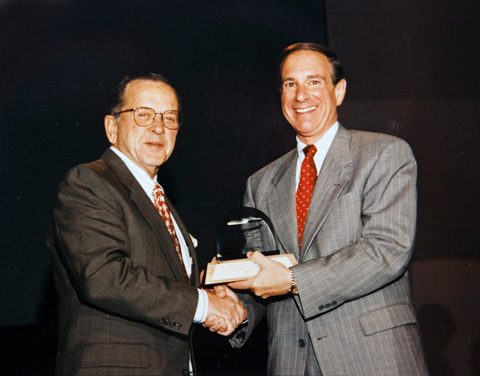 Stevens receiving award