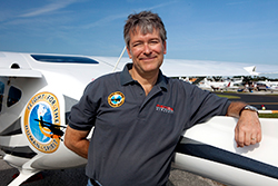 Michael Combs leans on the Hope One - the Remos he will fly to all 50 states.