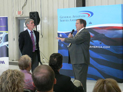 Sen. Mark Udall (left) and AOPA President Craig Fuller fielded questions from Denver-area pilots.