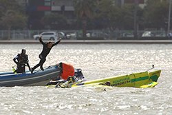 Rescue divers rush to the aid of Adilson Kindlemann of Brazil after he crashes into the Swan River during the Red Bull Air Race Training day on April 15, 2010 in Perth, Australia. Photo: Cameron Spencer / Getty Images for Red Bull Air Race