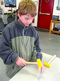 David Medina of the New Market Troop 4628 helps build a wing rib.