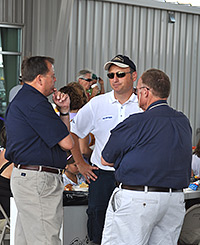 John Gallo, center, speaks with volunteers at Indiana Executive Airport's Fifth Annual Fly-In and Open House.
