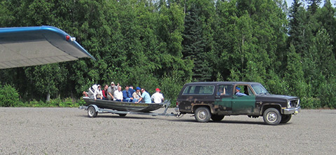 Members of Russian FATA enjoy a ride in a boat taxi at the Skwentna Roadhouse.