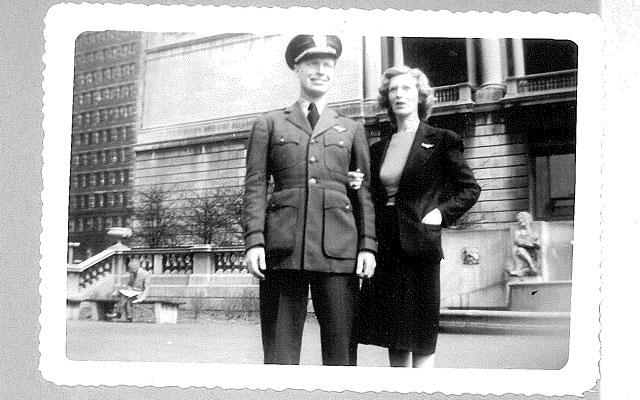 Mitchell Flint dressed in Navy aviation greens posed with his mother for a photo.
