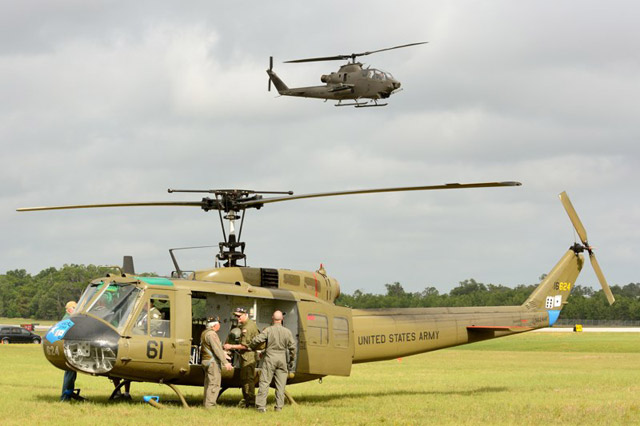 AAHS crew ready the Huey for its next flight as the Cobra approaches for landing.