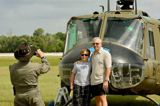Andrew and Michael Megler have their photo taken after flying in the Huey.