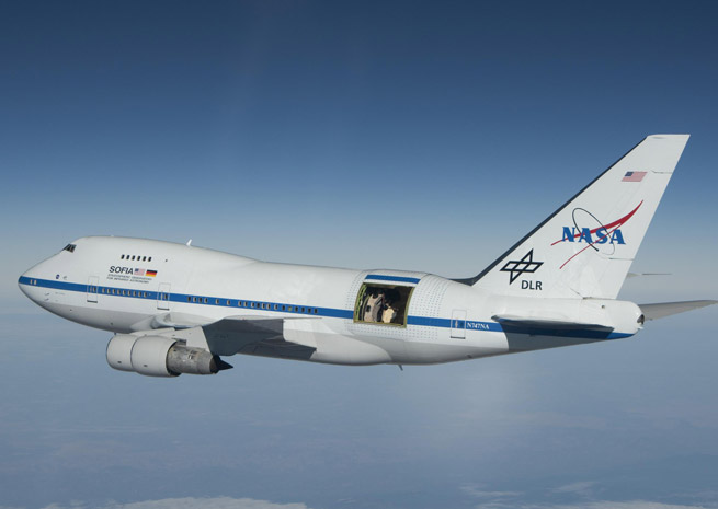 NASA's Stratospheric Observatory for Infrared Astronomy is mounted in a highly modified Boeing 747, fitted with an open door to the atmosphere and pressure barriers that protect passengers and crew from the elements at 45,000 feet. NASA photo.