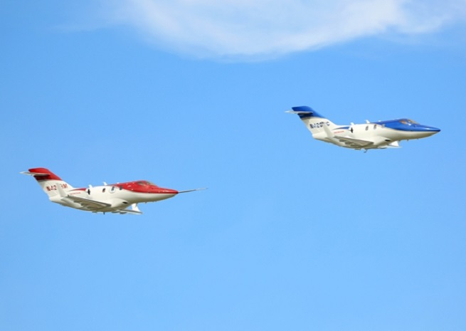 Two conforming HondaJets in formation at EAA AirVenture 2013