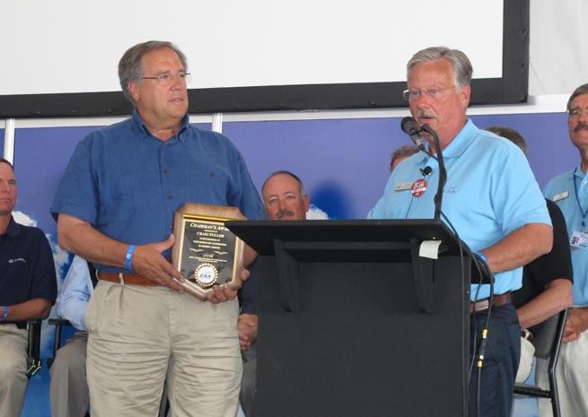 EAA Chairman Jack Pelton presented AOPA President Craig Fuller with the EAA Chairman's Award during the Stronger Together forum.