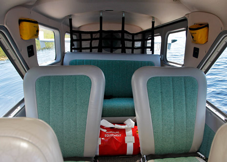 The passenger cabin is spacious, and a fishing rod holder in the rear bulkhead is one of many modifications.
