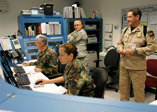 Silverstein recognized the uniform insignia worn by the man at right, a staffer of the Air and Marine Operations Center working with military personnel. U.S. Department of Homeland Security photo.