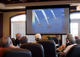 A PowerPoint presentation shows four RV-8s in a diamond.