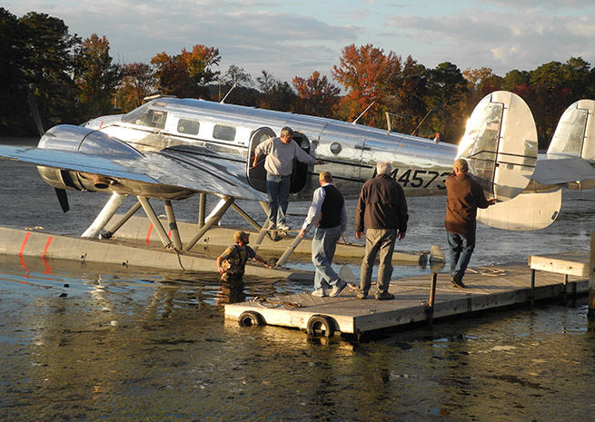 It takes a village to prep a Beech 18 on straight floats for flights. In Guntersville, AL, airport manager Matt Metcalfe wades in to help position the airplane after fueling.