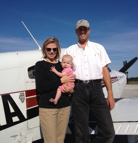 Meredith and Dana Holladay, who flew a Piper Cub to all 48 lower states in 2012, pictured with their daughter, Alex.