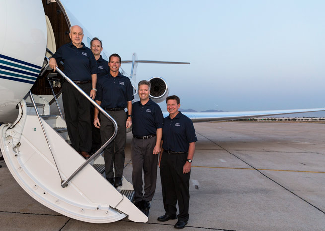 The Gulfstream flight crew for the G650's around-the-world record. From left: Tom Horne, Bud Ball, Eric Parker, Ross Oetjen, and John McGrath.
