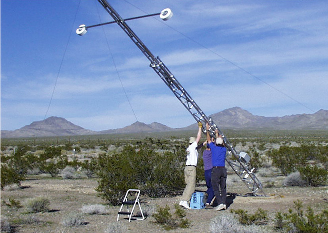 National Oceanographic and Atmospheric Administration personnel raise a 10-meter meteorological tower. NOAA photo.