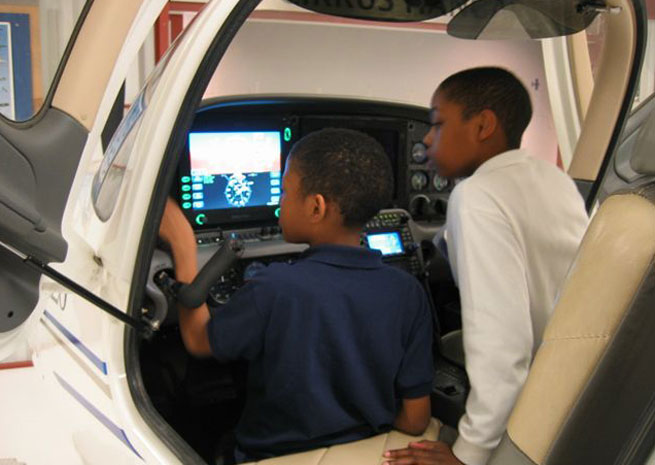 Children learning at Seattle's Museum of Flight. Photo courtesy of Seattle's Museum of Flight.