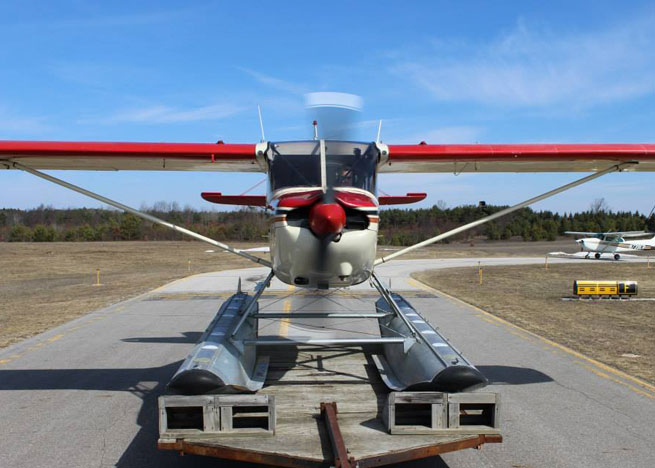 The trailer has an extension to add distance between the aircraft and pickup truck ahead. Photo by Robert Ericson, Orchard Beach Aviation.