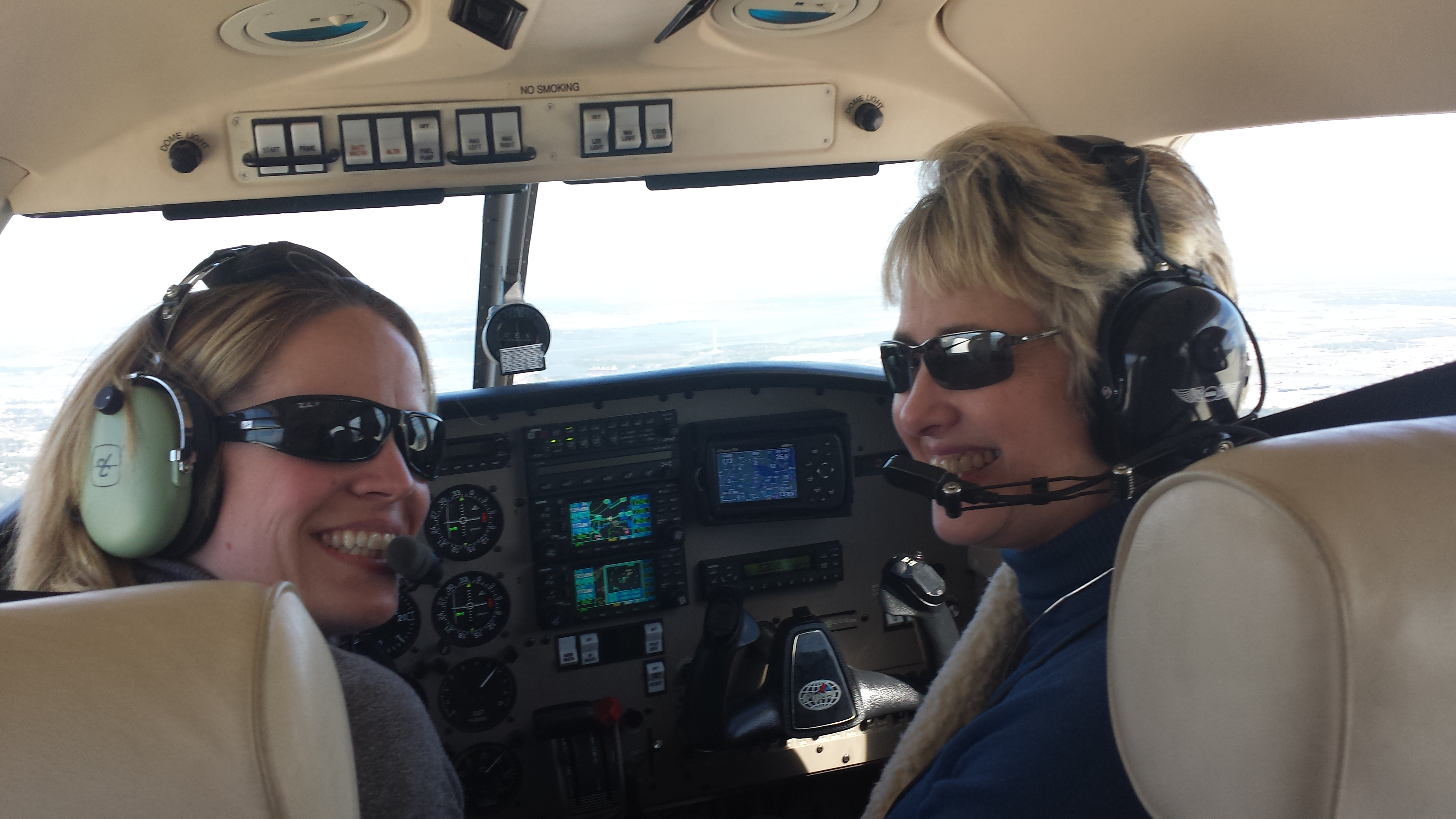 AOPA Central Southwest Regional Manager Yasmina Platt (left) takes Houston Mayor Annise Parker for a flight over the city.