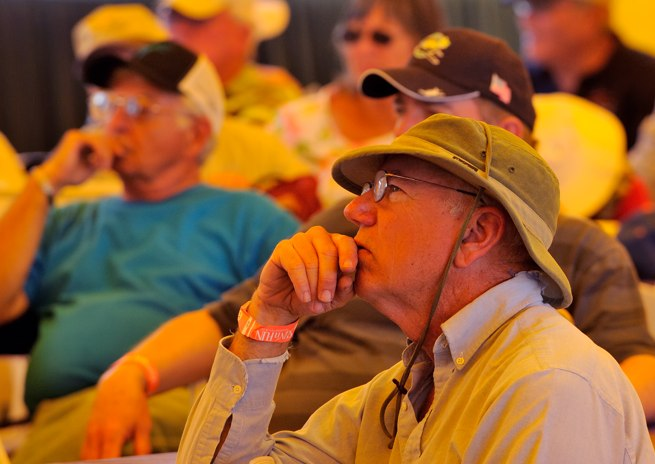 Pilots listen to a seminar about portable ADS-B in the AOPA forum tent.