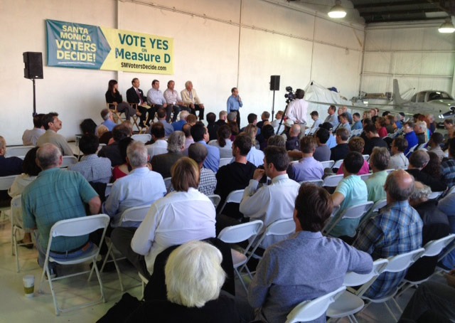 A crowd of Santa Monica Airport supporters gather to learn about a ballot measure in November that could help save the airport.