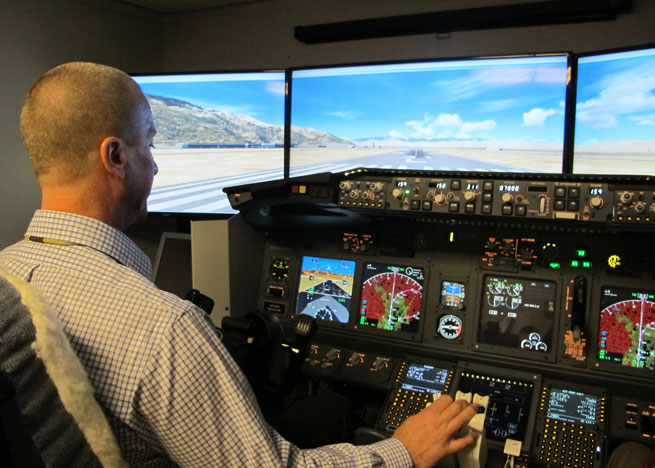 Honeywell's Steve Johnson demonstrated the company's takeoff performance monitor technology in a simulator.