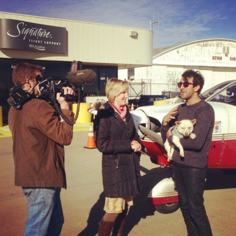 Phillip Angert (right) holds Yoshi as he talks to a news crew from a local Wichita TV station. (Photo courtesy Phillip Angert)