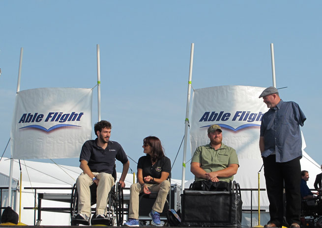 Able Flight honored Tim Klemm, Ellen Howards, Curtis Stanley, and Jason Gibson with wings after they earned their sport pilot certificates through the group's training program with Purdue University.