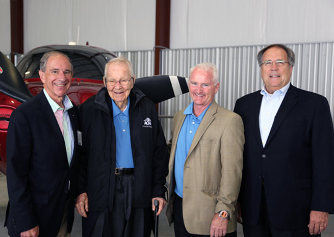 Former AOPA President Phil Boyer, charter member Earle Blomeyer, AOPA President Mark Baker, and former AOPA President Craig Fuller celebrate AOPA's seventy-fifth anniversary at Wings Field.