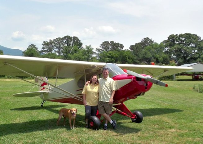 April and Chris Nesin with their restored Cub.
