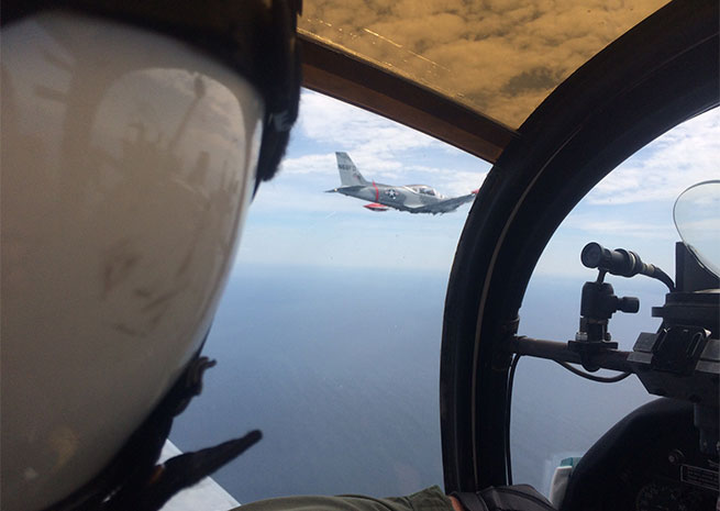 View from the cockpit, flying formation over Cape Cod Bay. Photo by Rhon Manor.