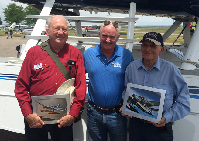 AOPA President Mark Baker recognizes long-serving AOPA members Clyde Osborn (left) and Bill Betts (right).