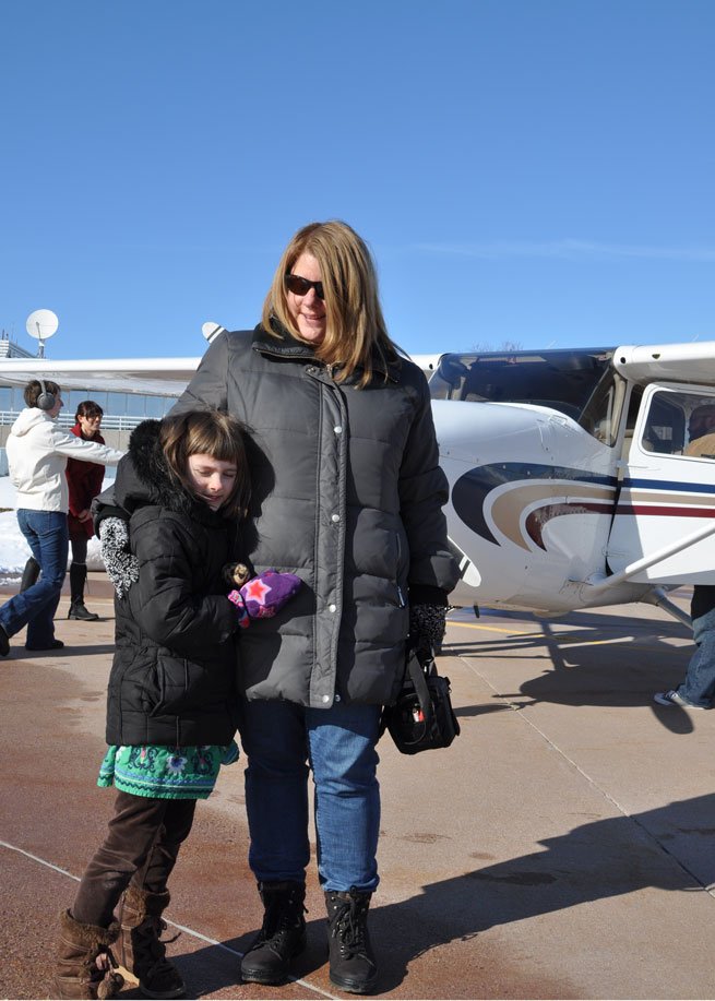 Esther Harbin and her mother, Susan Gray, got an aerial view of their hometown during the flight.