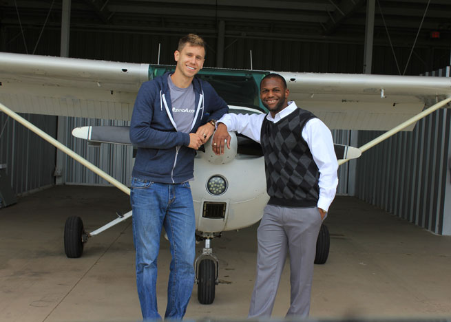 Rodney McKnight (right), winner of the 2013 Ceci Stratford Flight Training Scholarship, passed his checkride March 3. Shown here with CFI Jason Schappert.