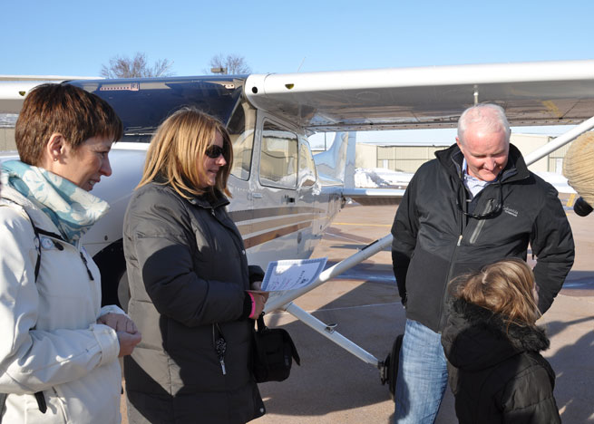 "After the flight, Harbin discussed hearing ""Echo"" in the aircraft's N number on the radio, and learned a bit about the phonetic alphabet. Left to right: Mireille Goyer, Women of Aviation Worldwide Week founder; Susan Gray; AOPA President Mark Baker; Esther Harbin."