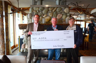 AOPA CEO Mark Baker receives a donation from WPA.