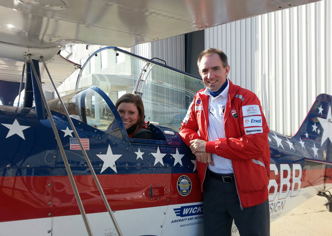Samantha Norton of IndyJet prepares to go on a thrill ride with airshow performer Billy Werth at Indianapolis Regional Airport.