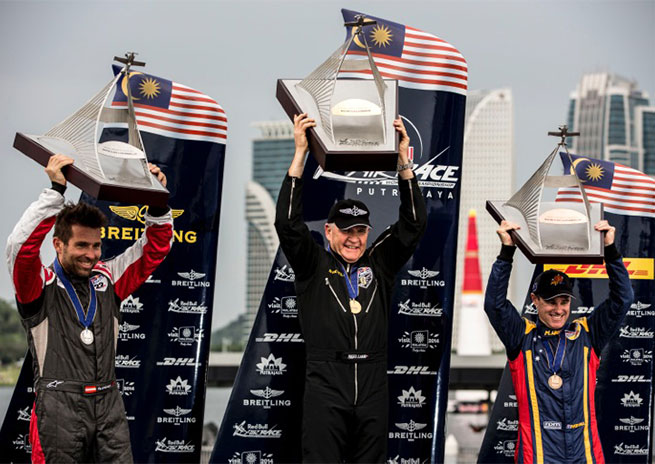 From left, Hannes Arch, Nigel Lamb, and Matt Hall share the Red Bull Air Race podium in Malaysia. Photo by Samo Vidic, courtesy of Red Bull.