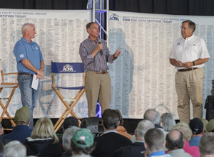 Former AOPA presidents Phil Boyer (center) and Craig Fuller (right) joined AOPA President Mark Baker (left) on stage during the Pilot Town Hall.