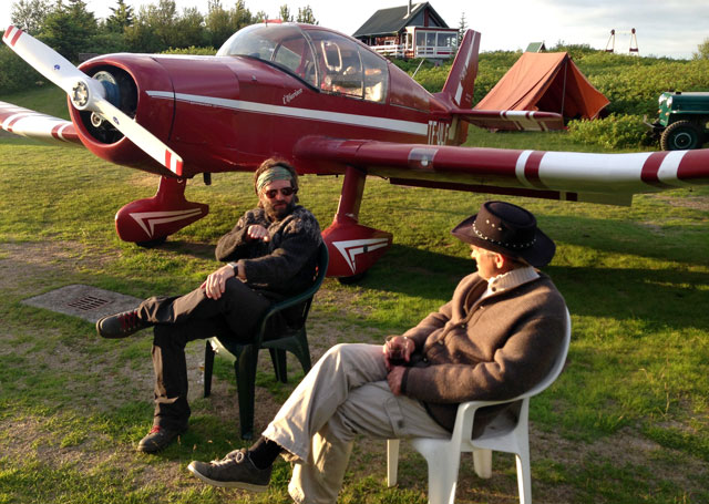 Haukur Snorrason, left, and his brother Jón Karl Snorrason relax in July, with their Jodel D.140C TF ULF in the background.