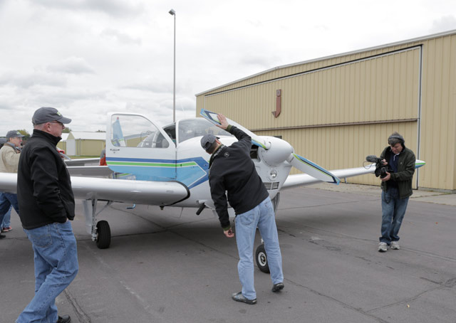 Steve Lagergren inspects his new airplane.