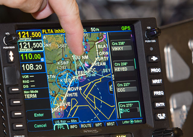 The IFD 540 has a touch screen interface that allows a flight plan to be amended by holding and dragging legs to new waypoints.