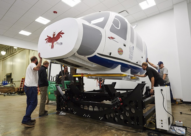Employees install Case Western's new simulator