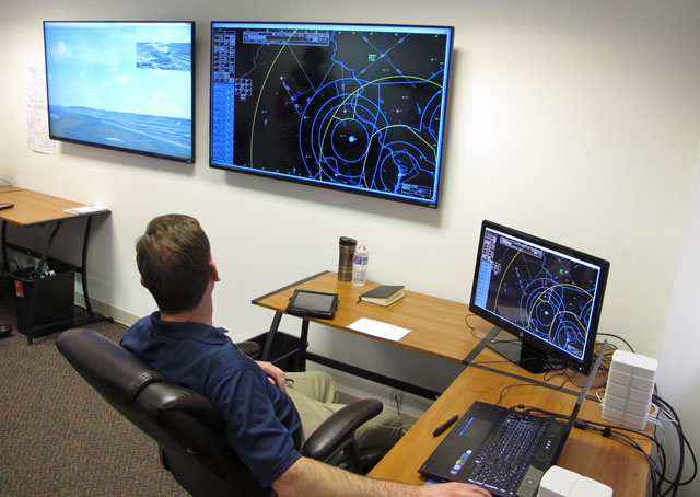 While he monitors virtual flights on a radar-like display in Mindstar Aviation's offices in Leesburg, Virginia, Greg Ashby can see the airport environment with an inset of an aircraft on another screen.