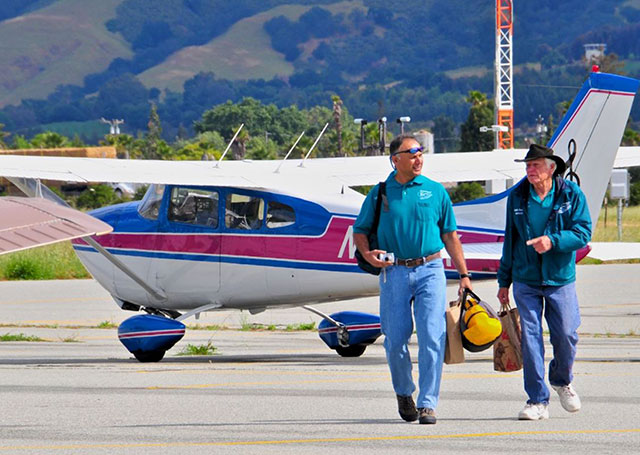 Vikas Kapur and Ralph Zerweck of the Santa Clara County Airman's association walking toward the DART Operations tent with food donations. Photo courtesy of SCAPA/Paul Marshall.