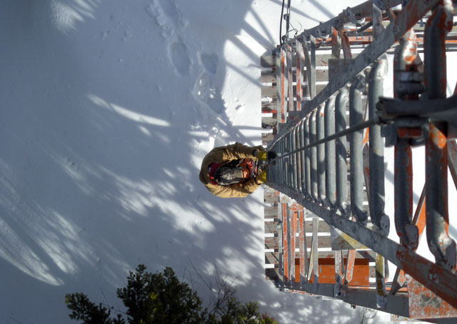 Climbing towers that can exceed 100 feet to change lightbulbs is not for the faint of heart. Photo courtesy of Mike Rogan, Montana DOT Aeronautics Division.