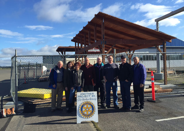 Community groups and the county cooperated to get the educational and inviting structure built. Left to right: Lee Smith, director, community Service, Rotary Club of Gig Harbor (morning club); Deb Wallace, Airport and Ferry administrator, Pierce County Airport and Ferry Division; Brett Marlo DeSantis, Rotary Club of Gig Harbor member and president, Brett Marlo Designs Inc.; Randy Barcalow, construction foreman/site manager, Rotary Club of Gig Harbor; Warren Hendrickson, Tacoma Narrows Airport AOPA Airport Support Network volunteer; Jay Simons, maintenance and operations supervisor, Pierce County Airport and Ferry Division; Roger Gruener, founder, Friends of Tacoma Narrows Airport (FOTNA); and Jim Castino, AOPA member, Tacoma Narrows pilot, Rotary Club of Gig Harbor member, project architect, and principal, Castino Architecture. Photo courtesy Warren Hendrickson.